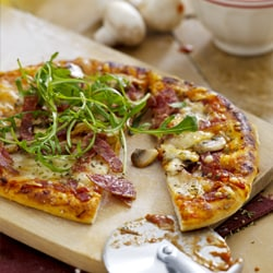 Pizza with salami, mozzarella and olives