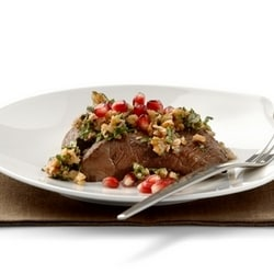 Venison steak with walnut sauce and pomegranate
